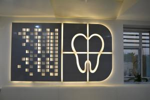 Roots dental clinic logo Prarthit Shah Architects Rajkot