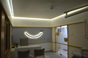 Smile dental clinic logo @ sardarnagar main road prarthit shah architects rajkot (11)